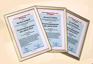 """Die Urkunden der """"Forschungssprecher des Jahres 2014""""."""